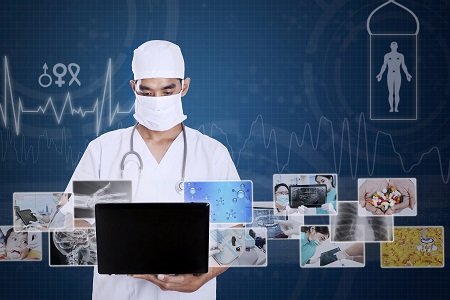 Male doctor working  on laptop with digital photo